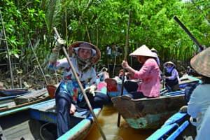 Women who row boats in Mekong Delta.