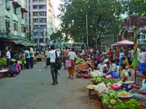 Snapshot of everyday Yangon life. Market on the street.